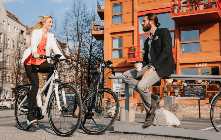 Young Couple Using Ebikes