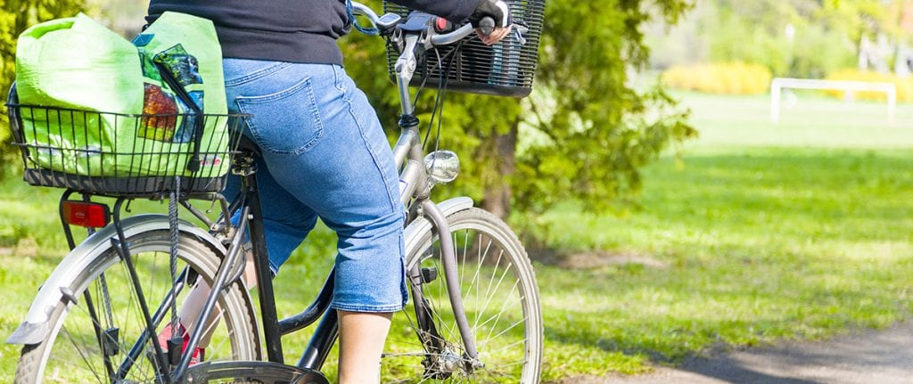 best electric bike for heavier riders woman riding with groceries