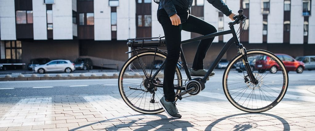 best mid drive electric bike with man riding it