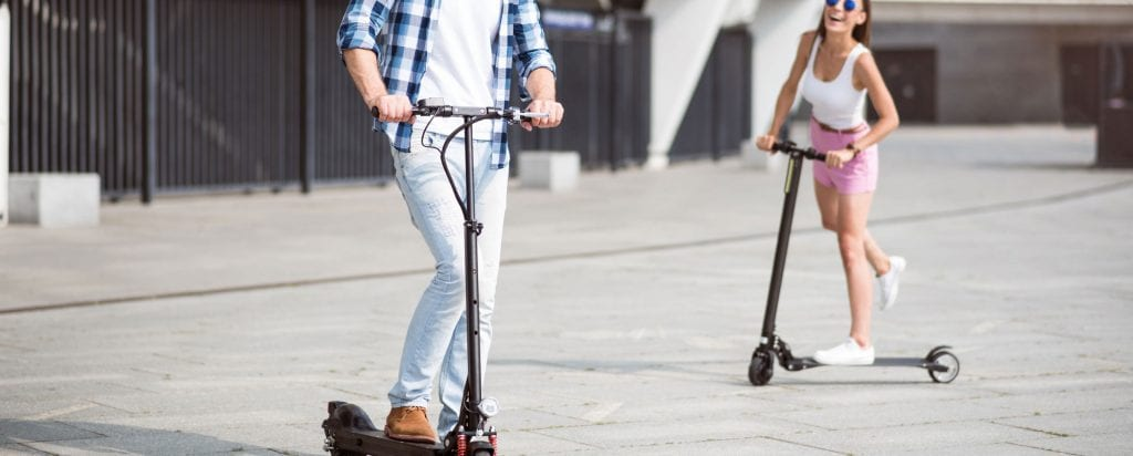 couple rides on the best electric scooters